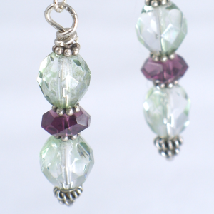 Green and Purple faceted crystal earrings with silver accents are elegant alternatives to red for valentines day. Made by Patricia C Vener