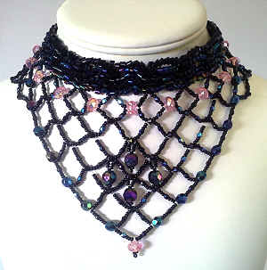 Art necklace, bead woven in black, rose, and aurora. Timeless as the dark night skies.