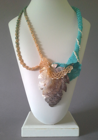 Bead woven work of art to wear abstraction of a beach in Summer.