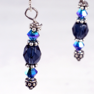 Mifnight blue faceted Czech crystal, peacock Swarovski bicones, fancy bali silver spacers and headpin, sterling silver earwires, $35.00 by Patricia C Vener