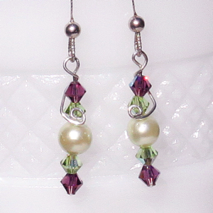 White Swarovski pearl with green and amethyst Swarovski bicones, wire wrapped with sterling silver headpin, sterling silver earwires, $25.00 by Patricia C Vener